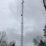 Tower crew climbing to install the antenna
